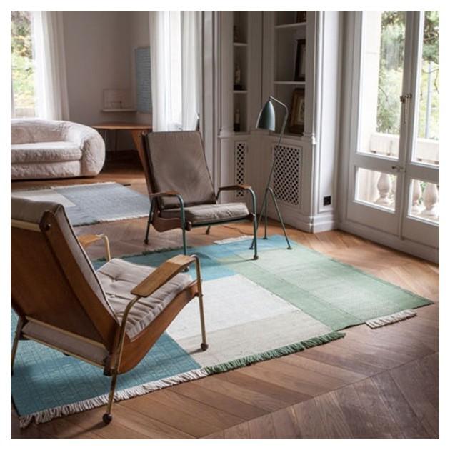salón con Alfombra Tres color verde Nanimarquina